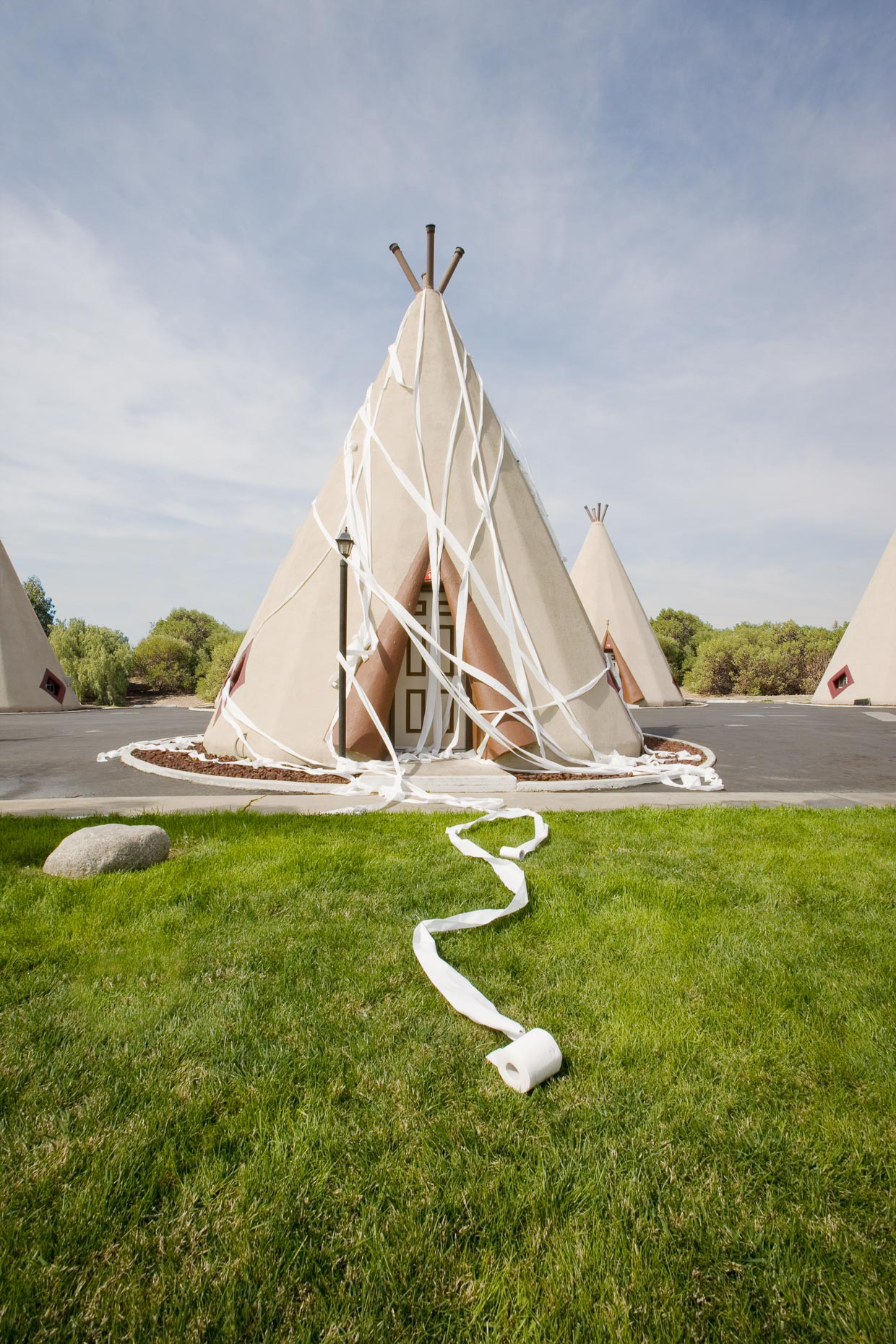 Toilet paper is strewn over teepee shaped motel unit building. David Zaitz.