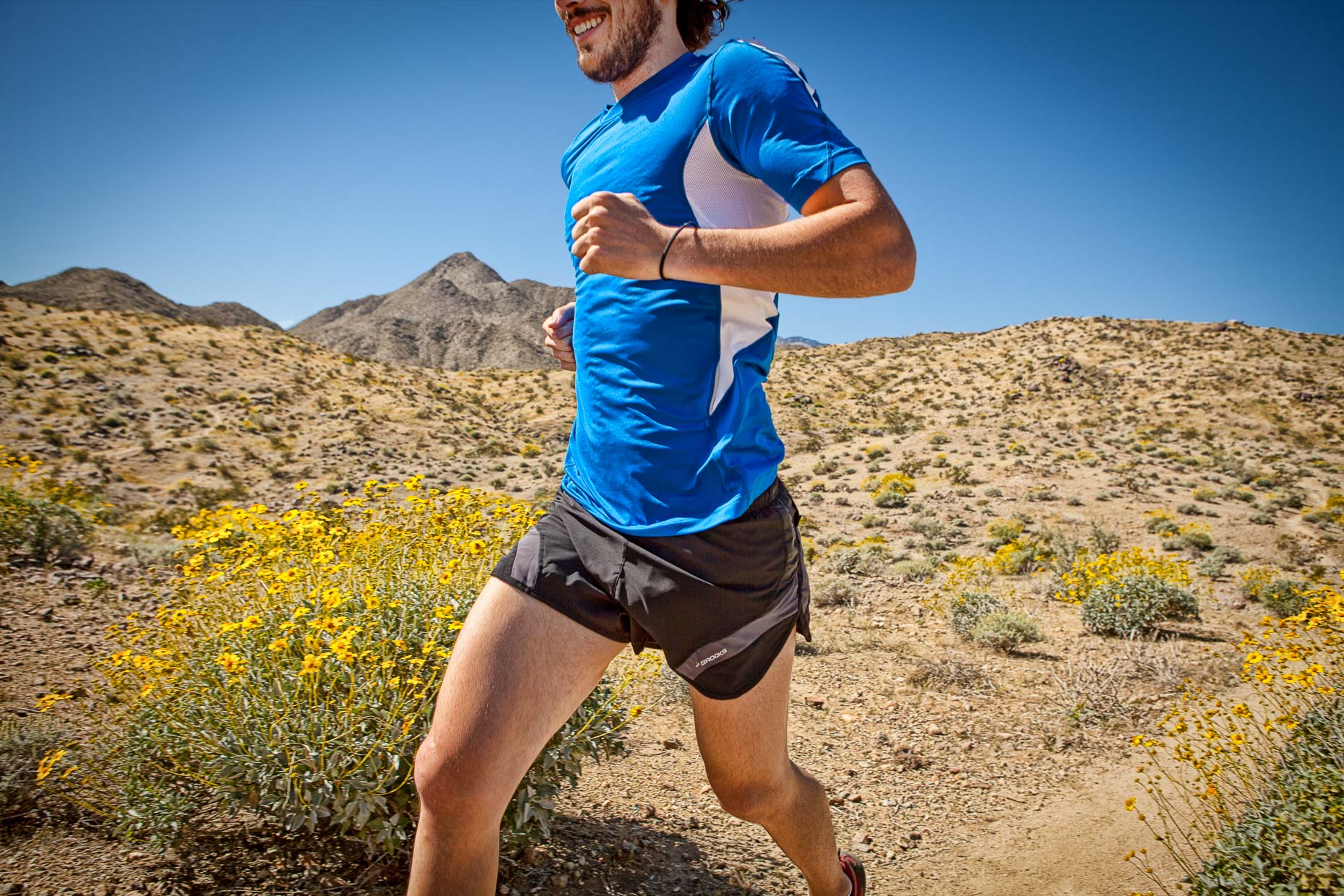 Torso of man running on desert trail in Palm Springs, California. Fitness. David Zaitz Photography.