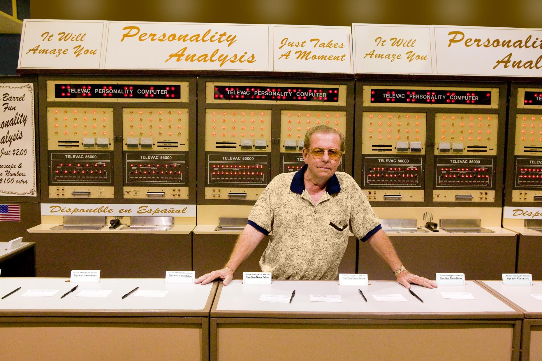 Portrait of man standing at county of handwriting analysis computer machine at Los Angeles County Fair in Pomona, California by David Zaitz