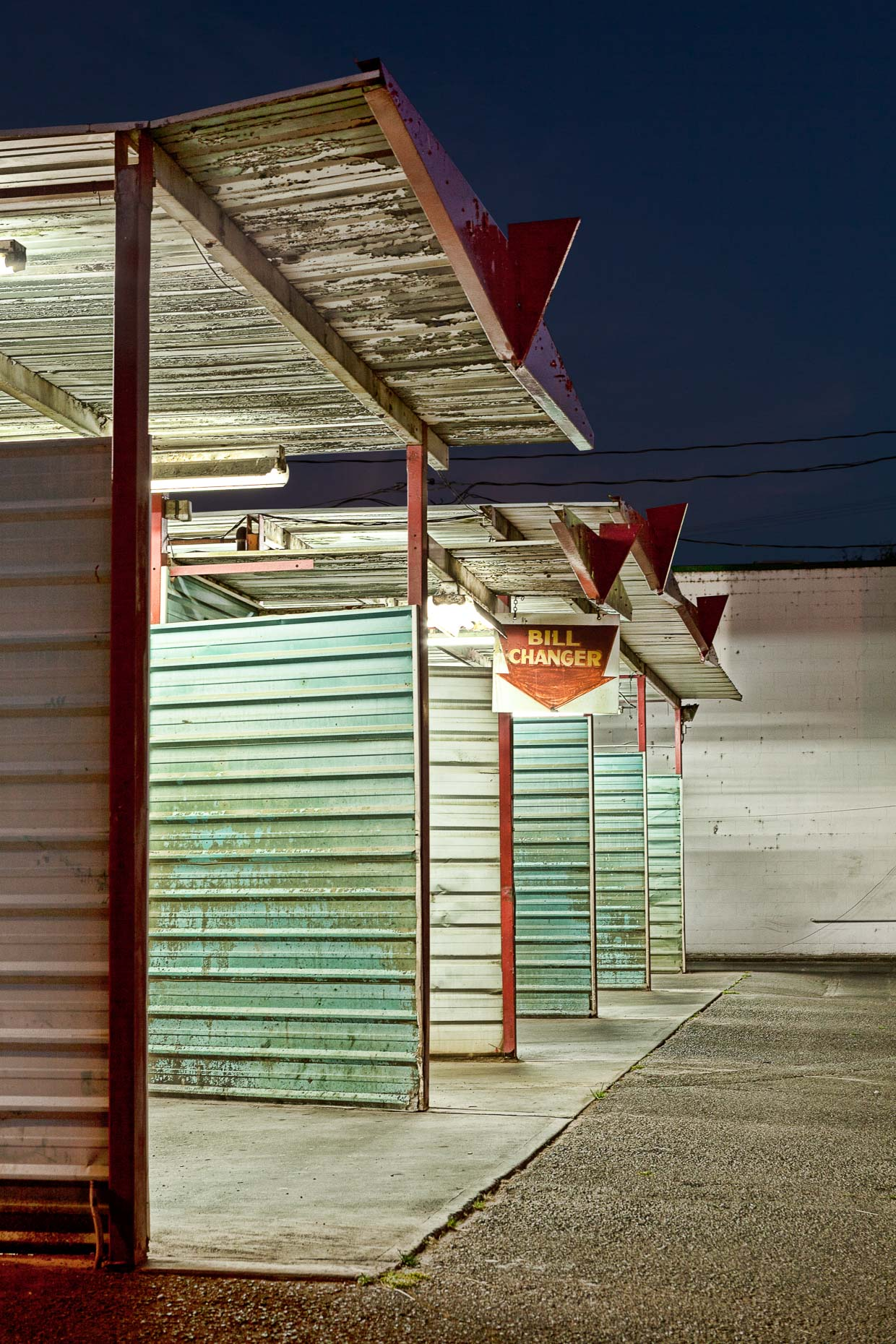 Coin operated car wash at night in Grants Pass, Oregon by David Zaitz