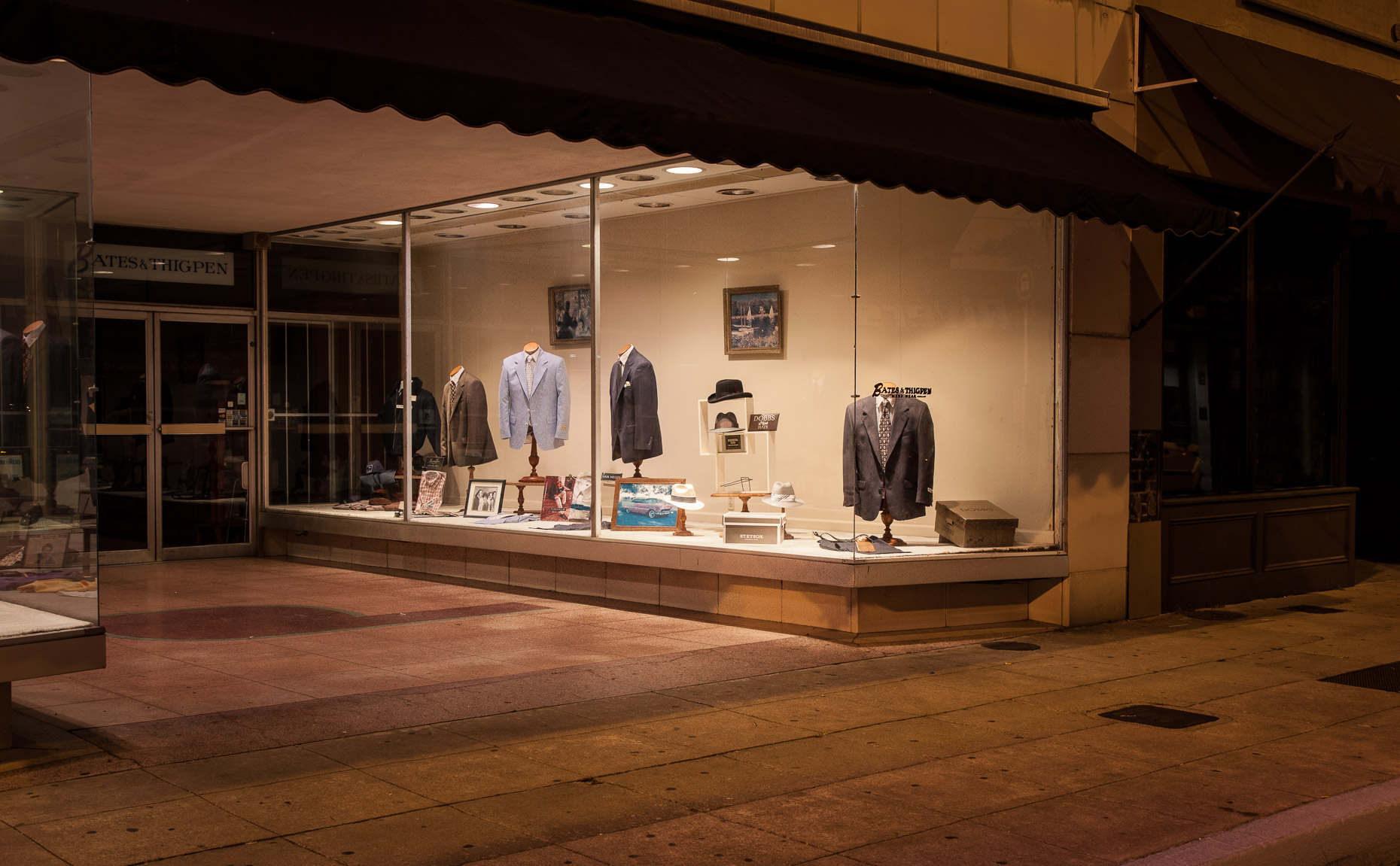 Retail store window at night with men