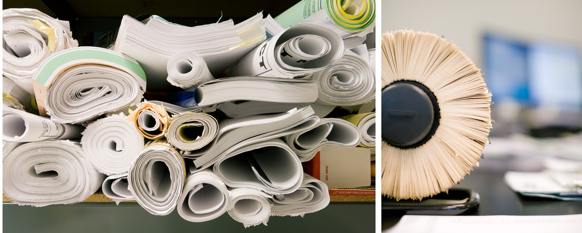 Rolls of blueprints and detail of Rolodex in office. David Zaitz Photography.