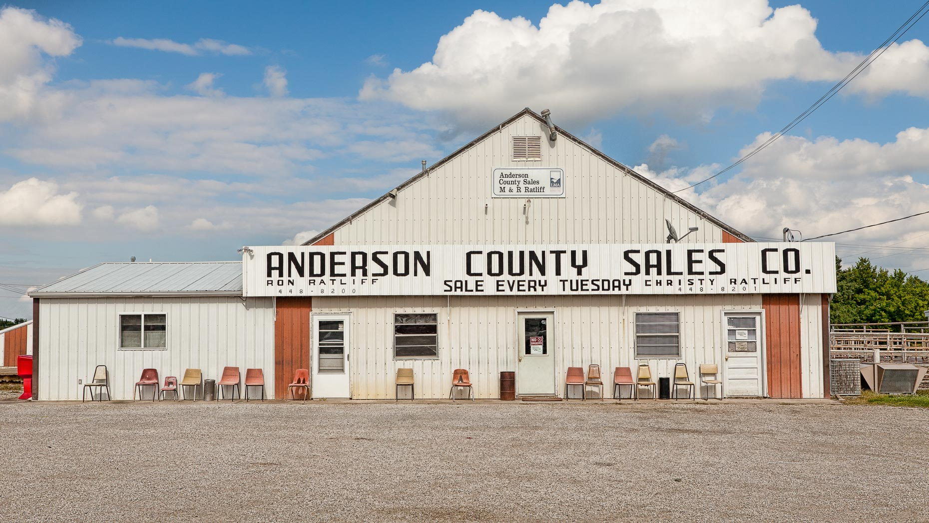 Chairs in front of ANDERSON COUNTY SALES CO. building by David Zaitz