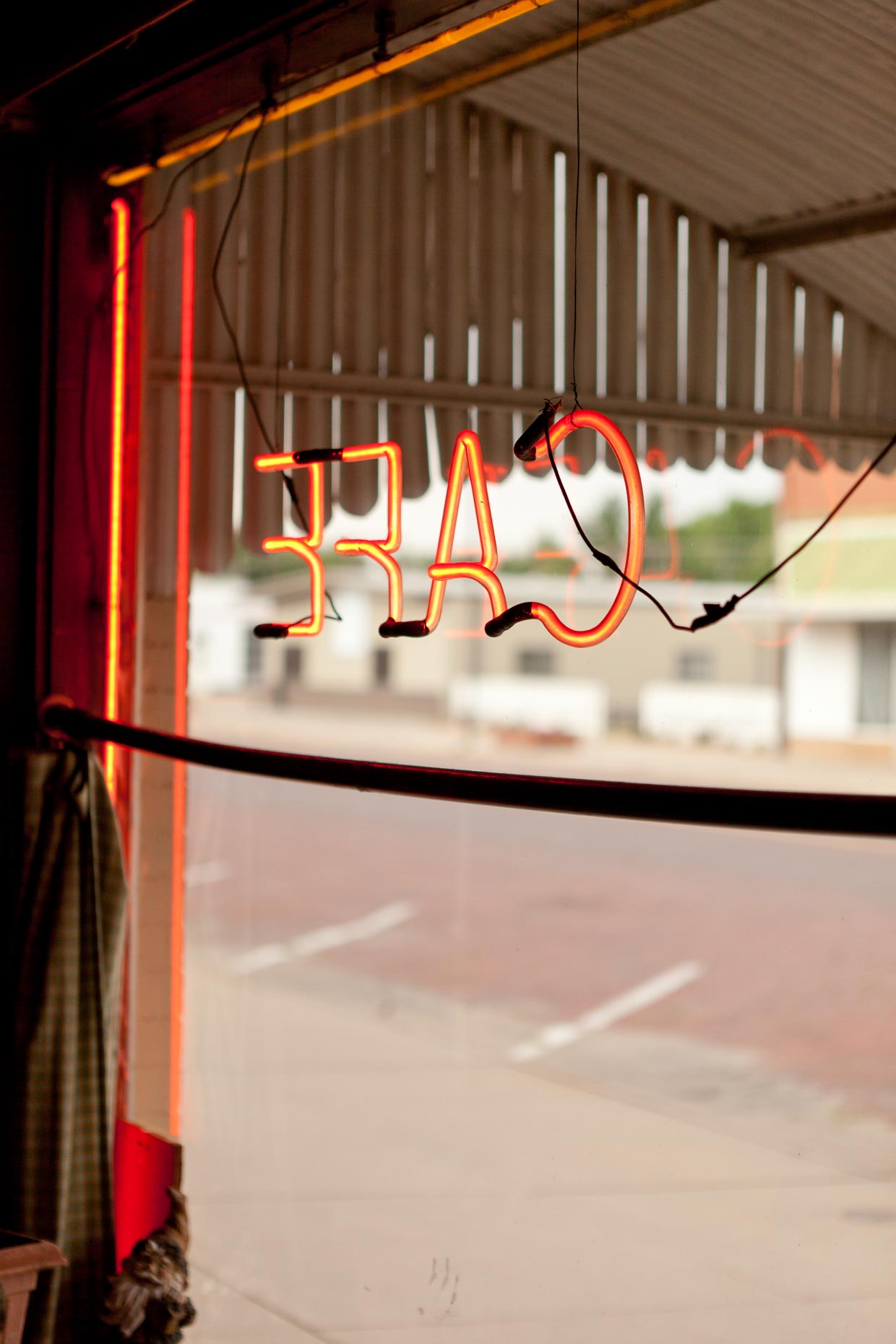 Neon cafe sign in restaurant window by David Zaitz