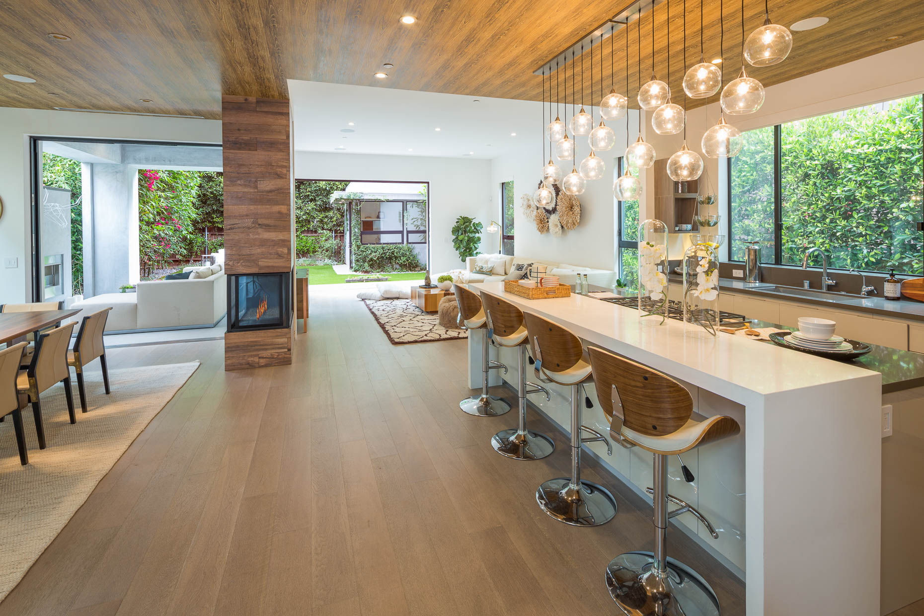 Architecture photograph of kitchen and great room in upscale residence in Los Angeles, California by David Zaitz