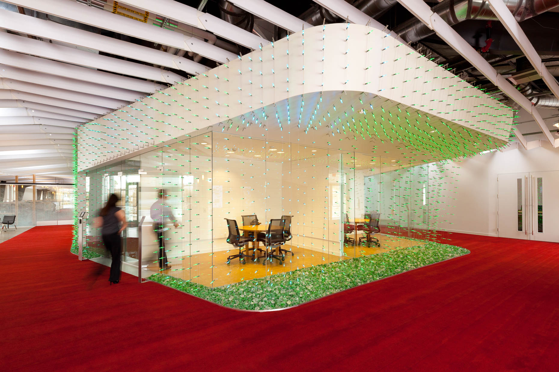 Modern architecture glass walled meeting room with green lights at Claremont University Consortium, Claremont College, California. David Zaitz Photography.