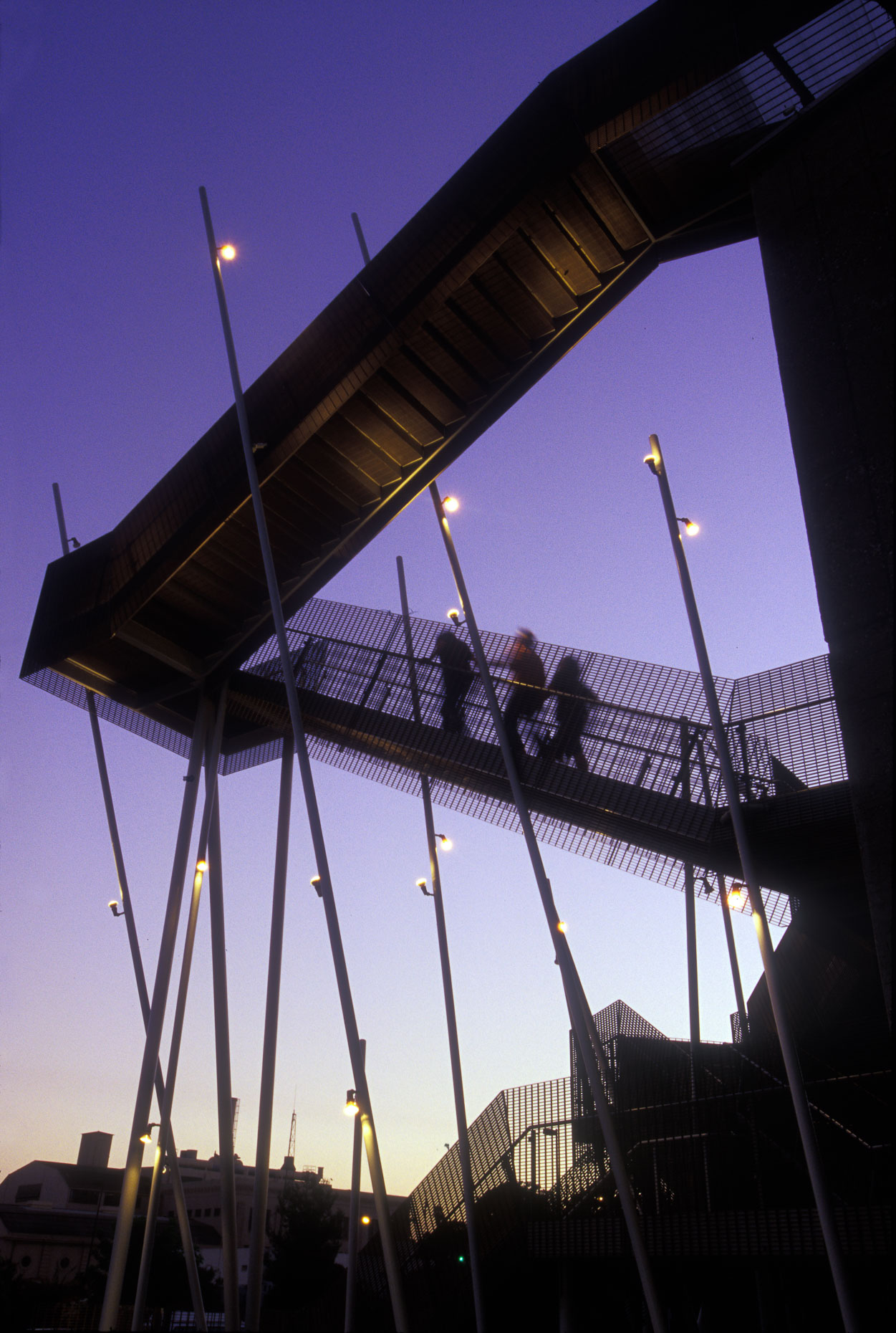People walking on exterior building staircase silhouette against dusk sky at Art Center College of Design in Pasadena, California. Architecture.  David Zaitz Photography.