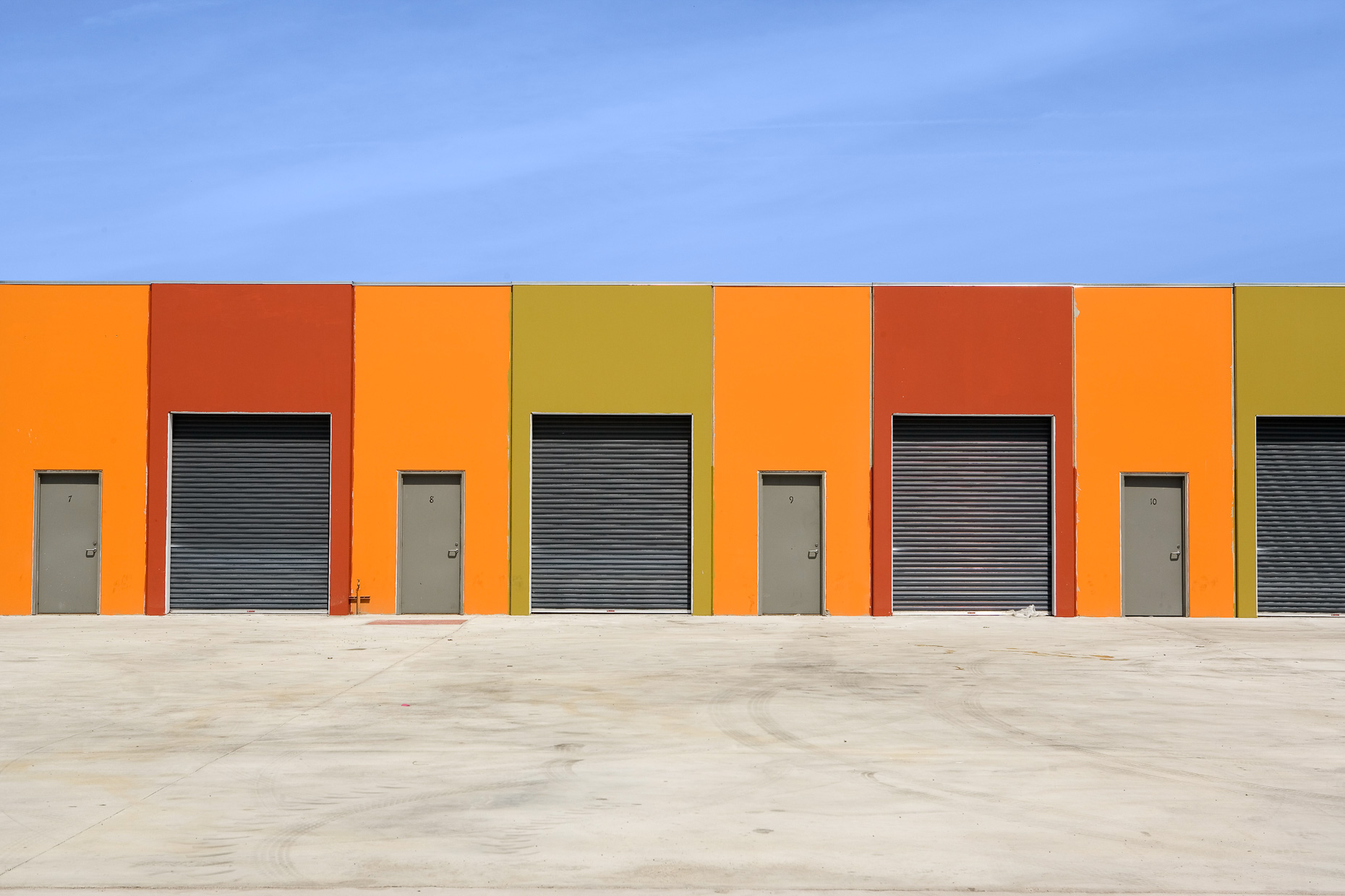 Industrial building with multi color panels and roll up metal doors.  David Zaitz Photography.