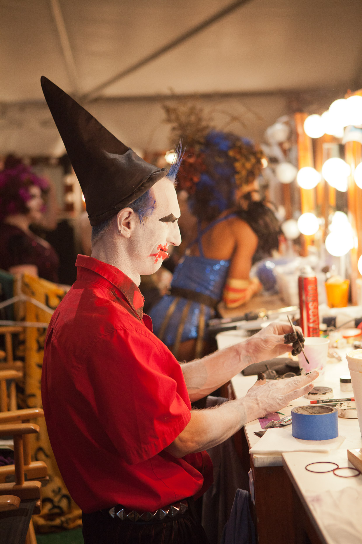 Performer applying makeup backstage at Cirque Berzerk circus performers, by David Zaitz