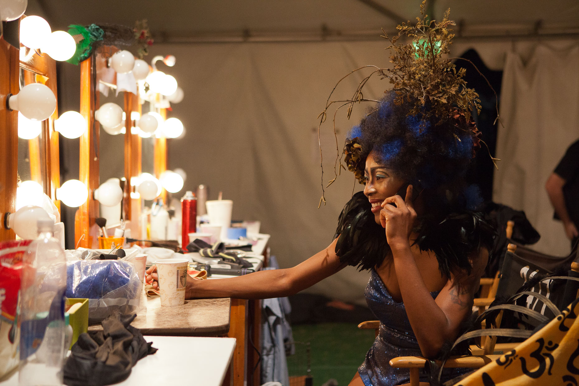 Performer talking on phone at makeup table at Cirque Berzerk circus performers, by David Zaitz