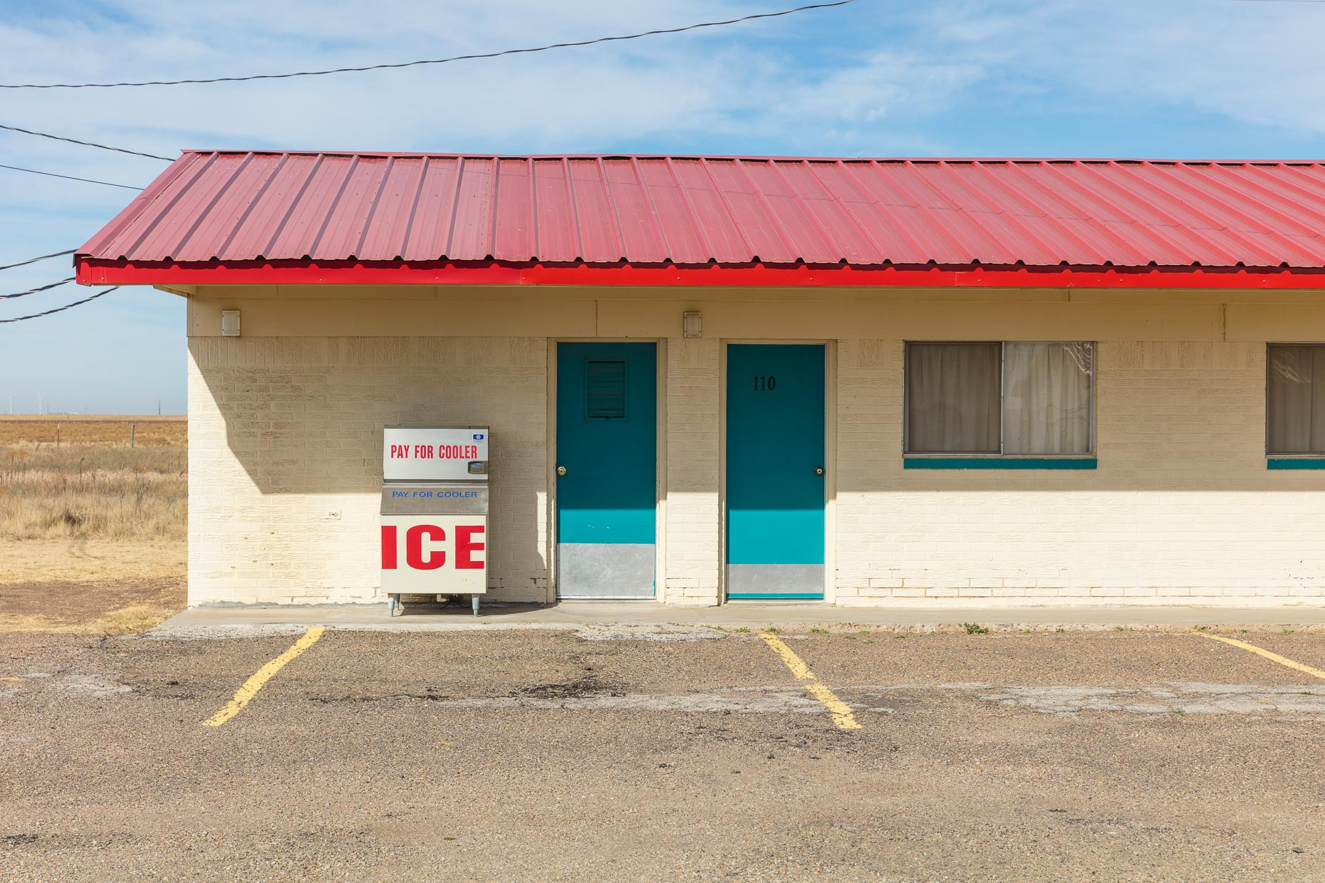 Ice machine in front of motel rooms along Route 66 in Conway, Texas