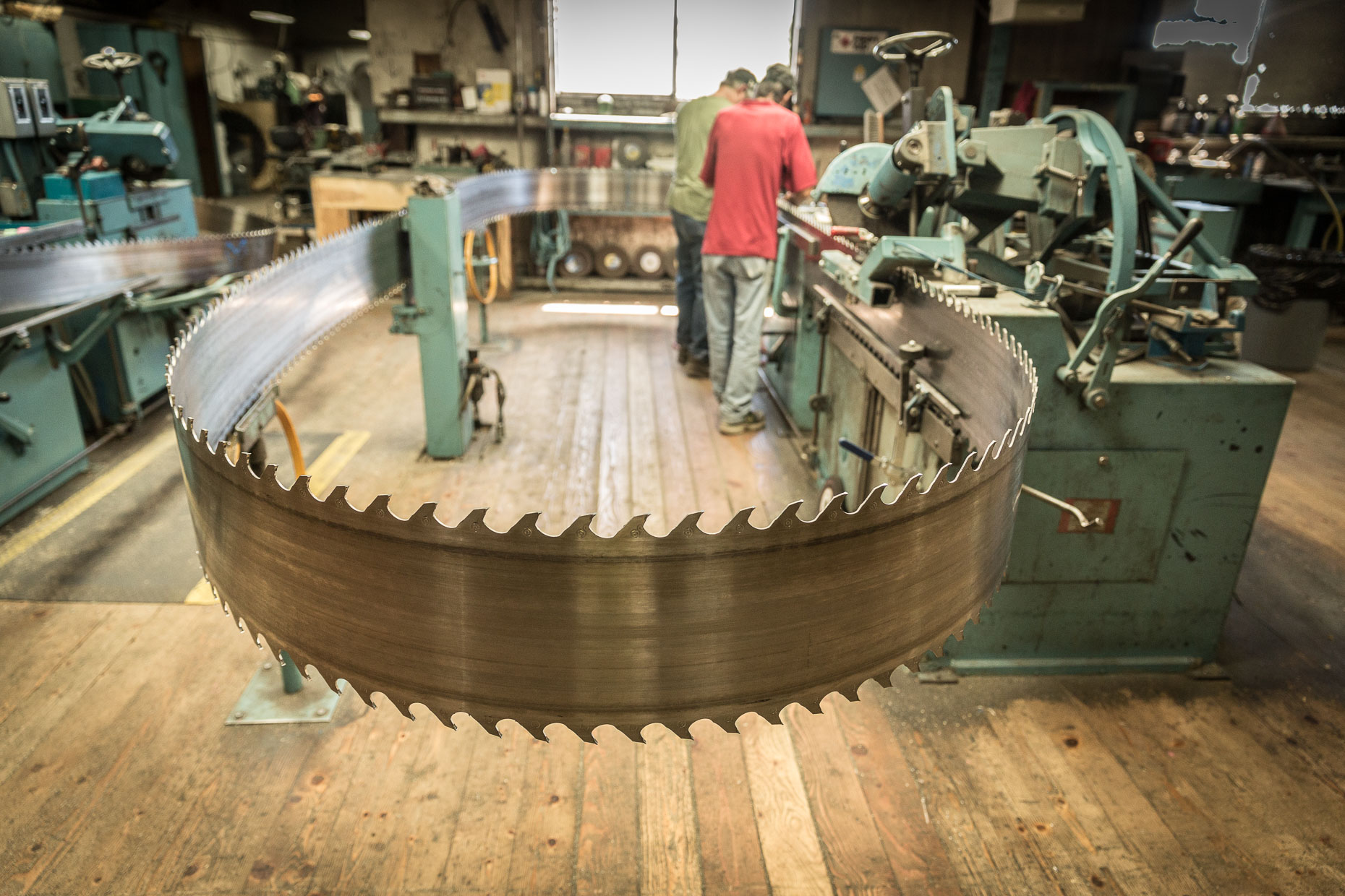 Band saw blade being sharpened in factory, Malheur Lumber Company mill in John Day, Oregon by David Zaitz.