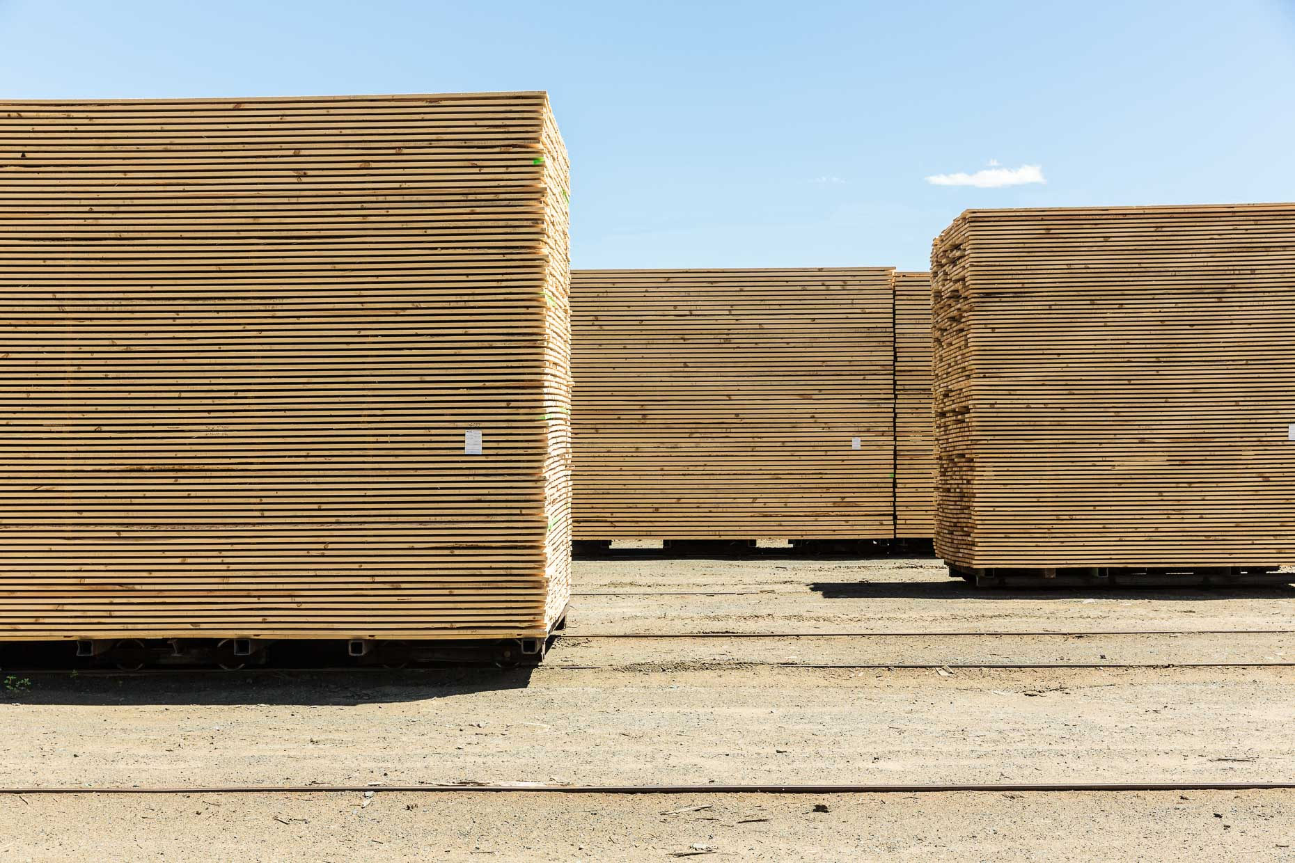 Stacks of finished lumber at lumber mill, Malheur Lumber Company mill in John Day, Oregon by David Zaitz.