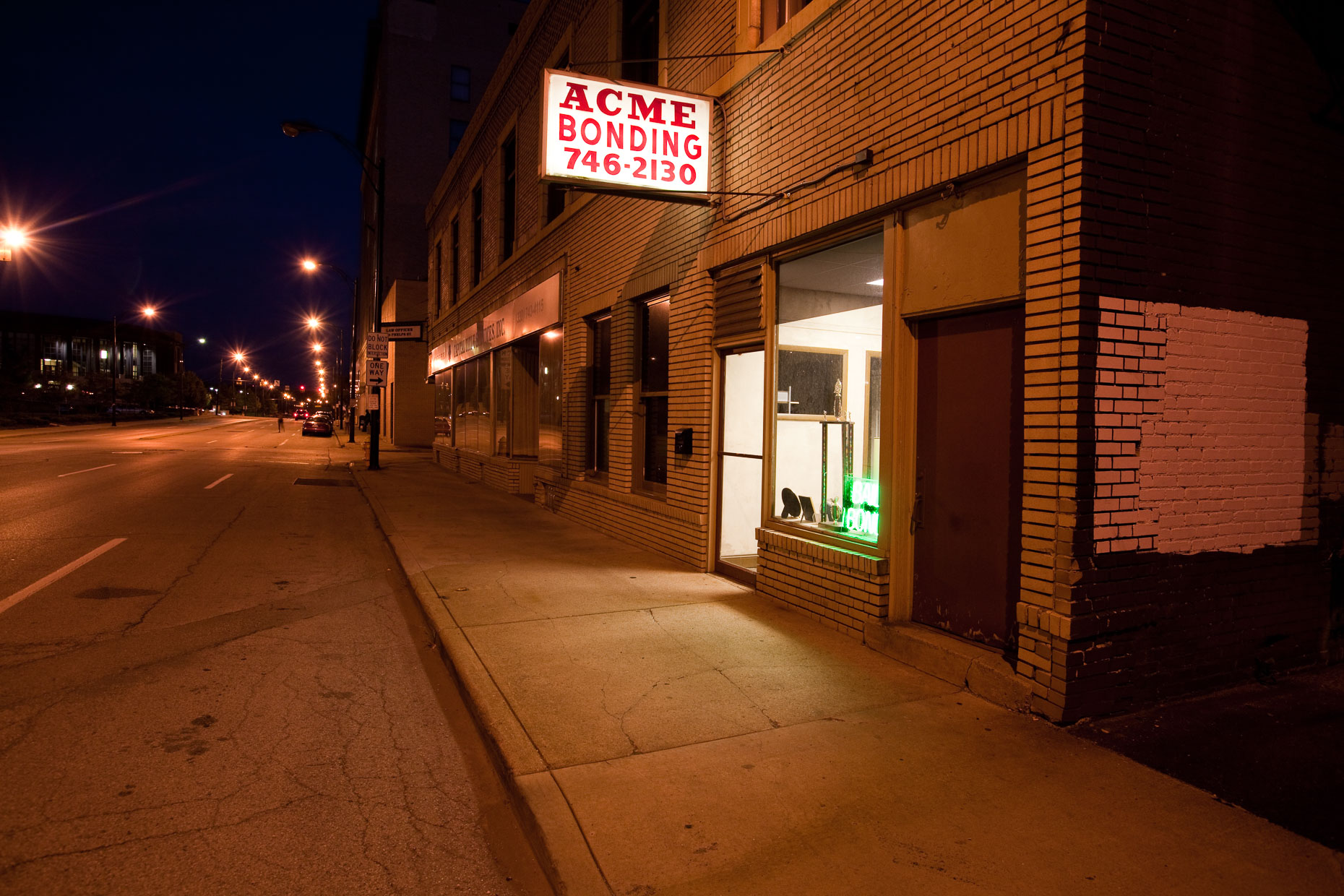 Bail bonds office at night on city street by David Zaitz