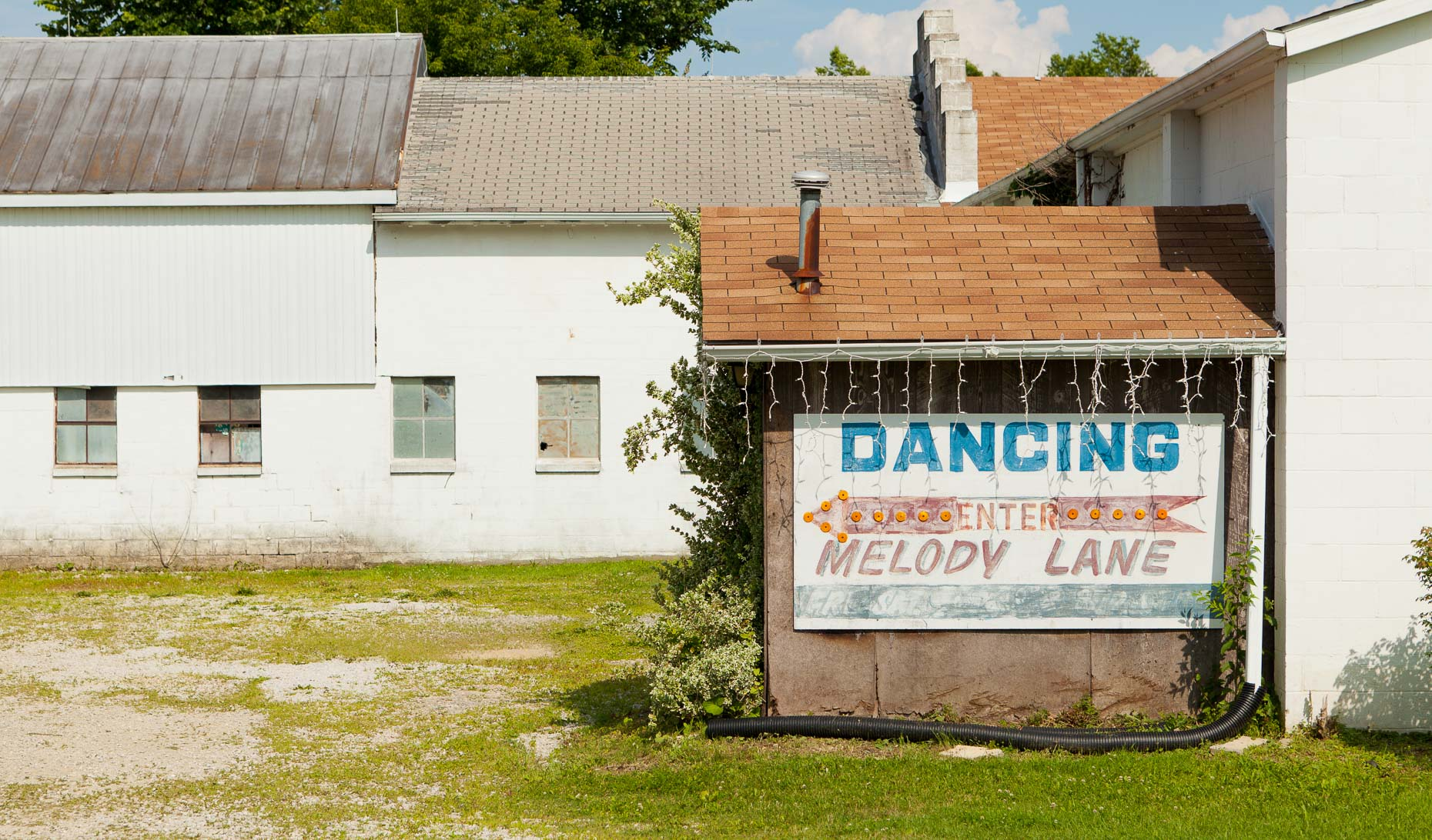 Sign on building DANCING ENTER MELODY LANE by David Zaitz
