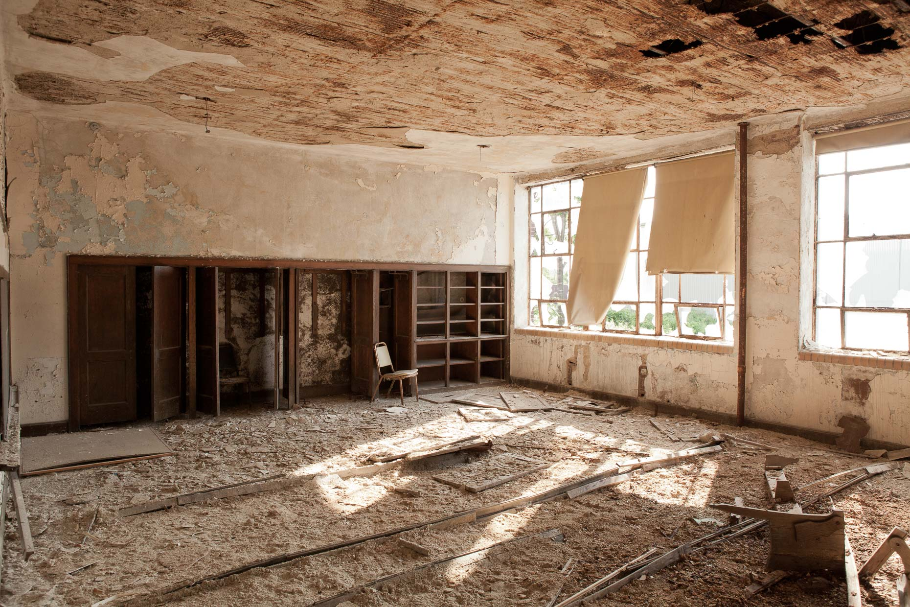 Interior classroom in abandoned school with peeling paint by David Zaitz