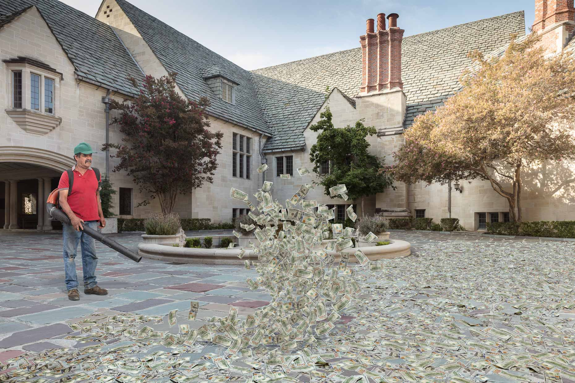 Gardener using leaf blower on hundred dollar bills on ground in courtyard of mansion.